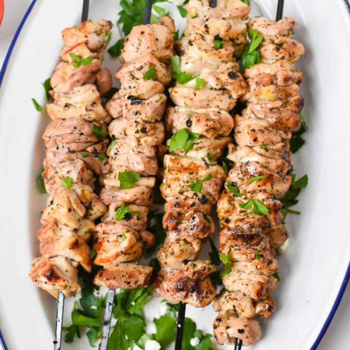 Chicken Souvlaki Recipe on a white platter.
