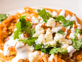 Chicken Tinga Recipe with sour cream and cilantro.