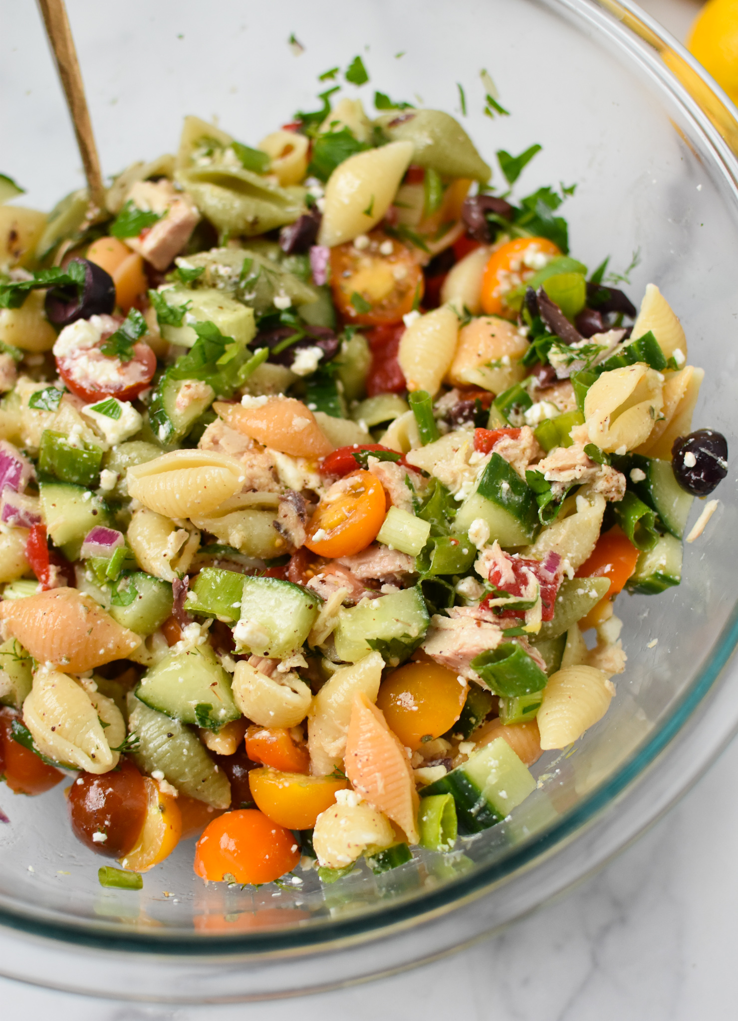 Mediterranean Tuna Pasta Salad in a clear bowl.