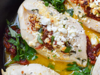 Sun-dried Tomato Goat Cheese Stuffed Chicken Breasts with basil.