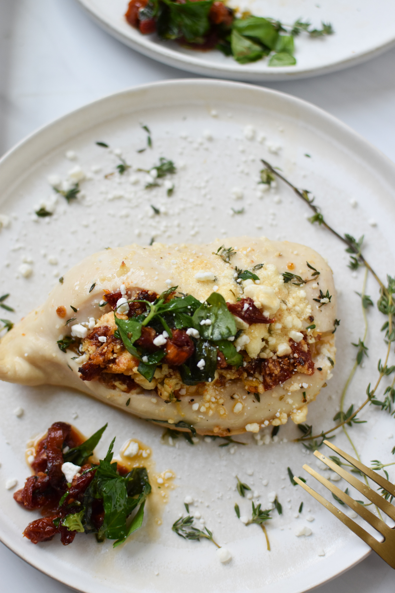 Sun-dried Tomato Goat Cheese Stuffed Chicken Breasts with thyme.