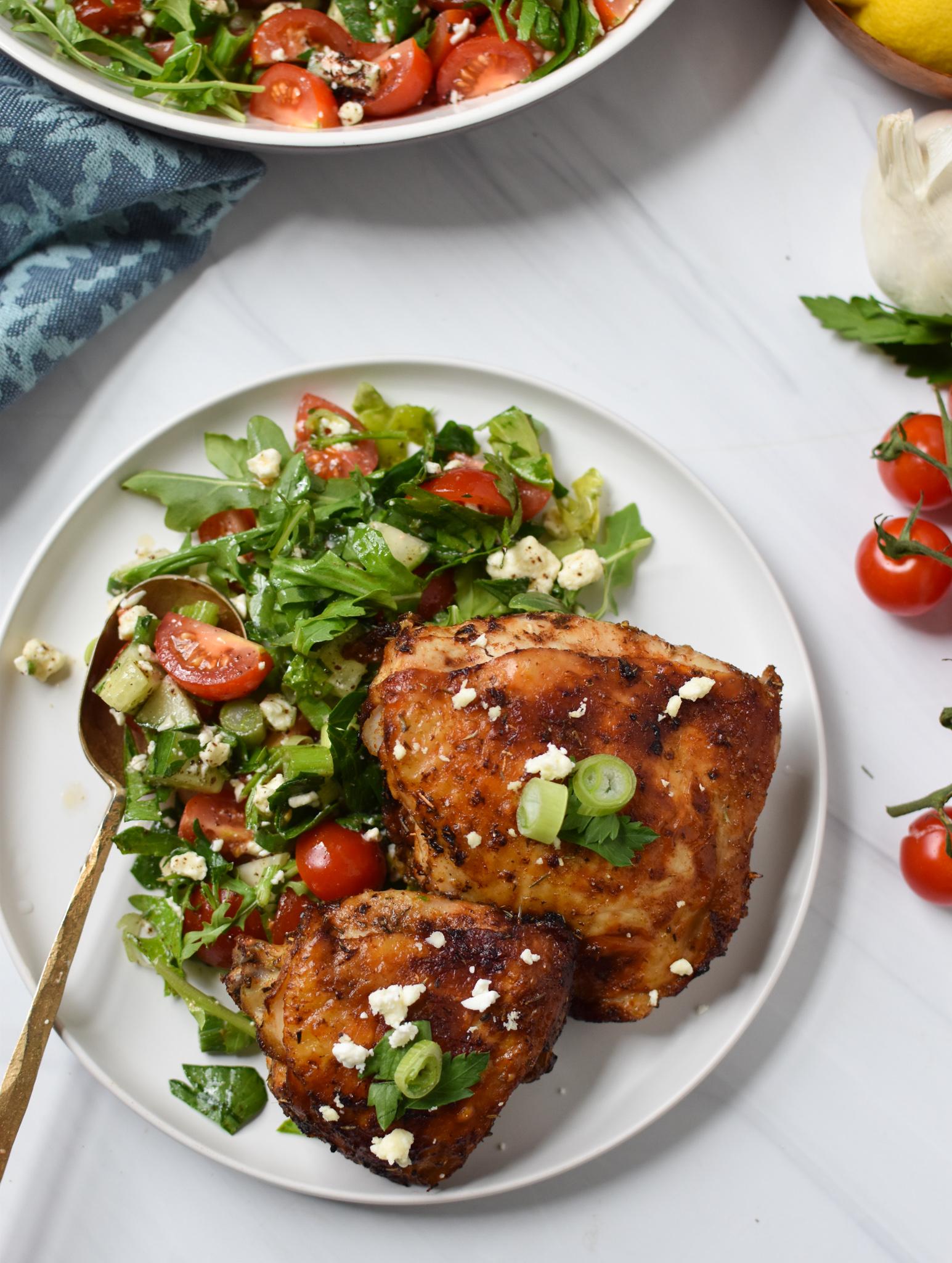 Air Fryer Mediterranean Chicken Thighs with spoon.