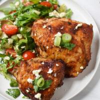 Air Fryer Mediterranean Chicken Thighs on a white plate.