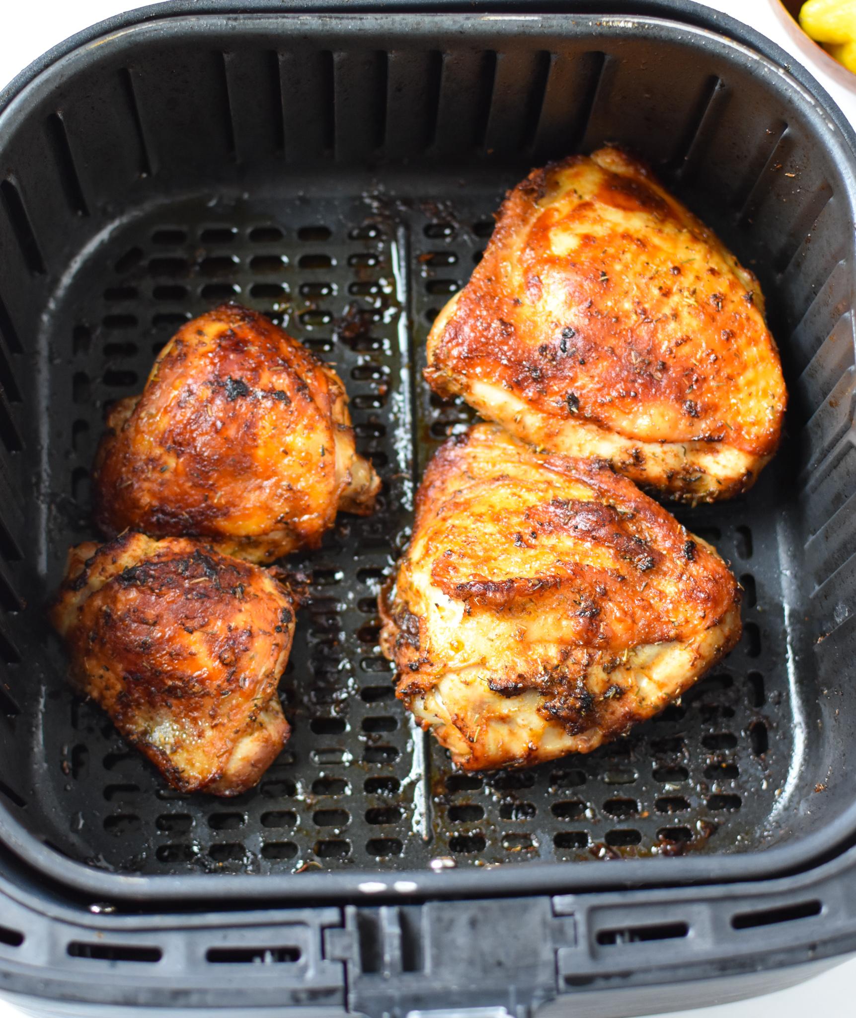 Air Fryer Mediterranean Chicken Thighs in an air fryer.