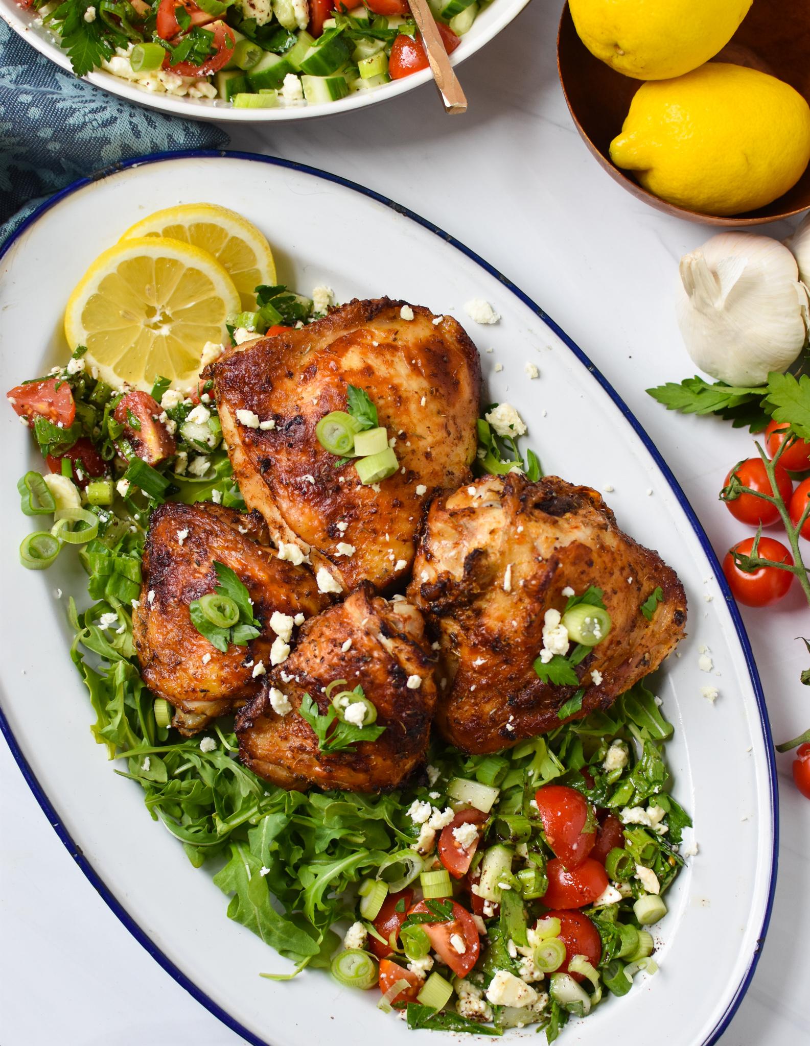 Air Fryer Mediterranean Chicken Thighs on white platter.
