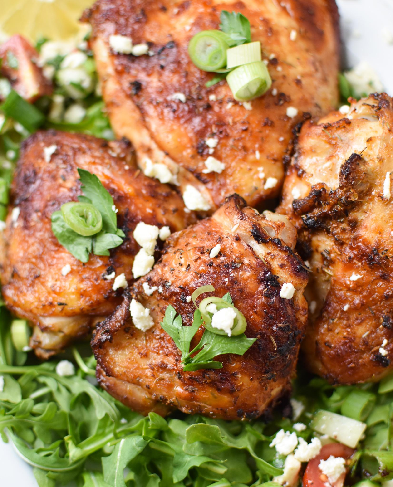 Air Fryer Mediterranean Chicken Thighs on a white platter.