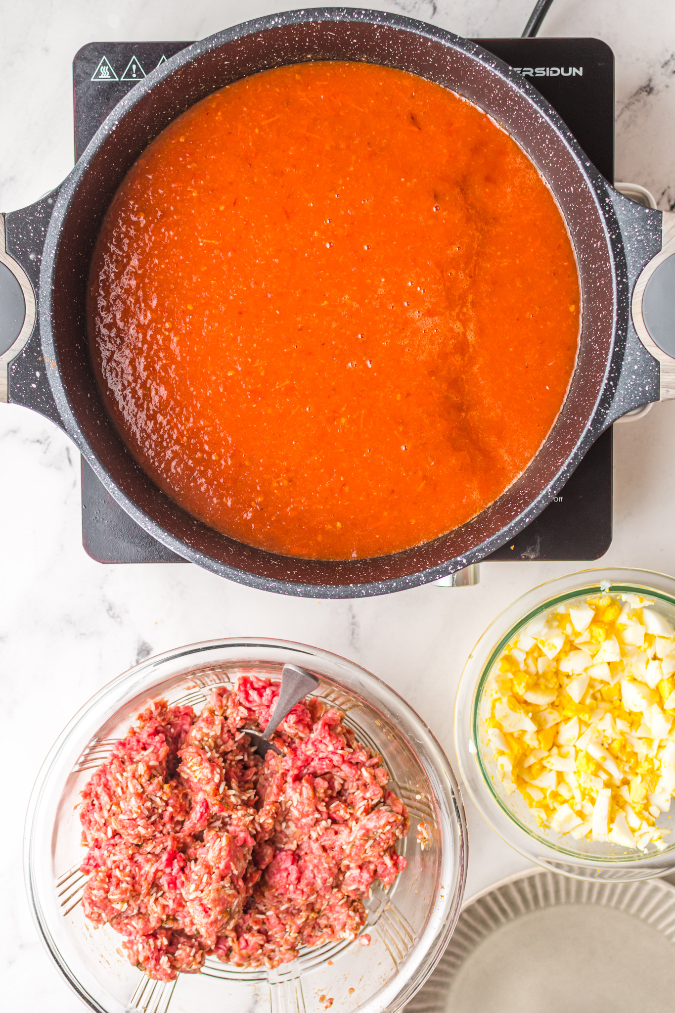 Albondigas en Chipotle sauce in a pot.