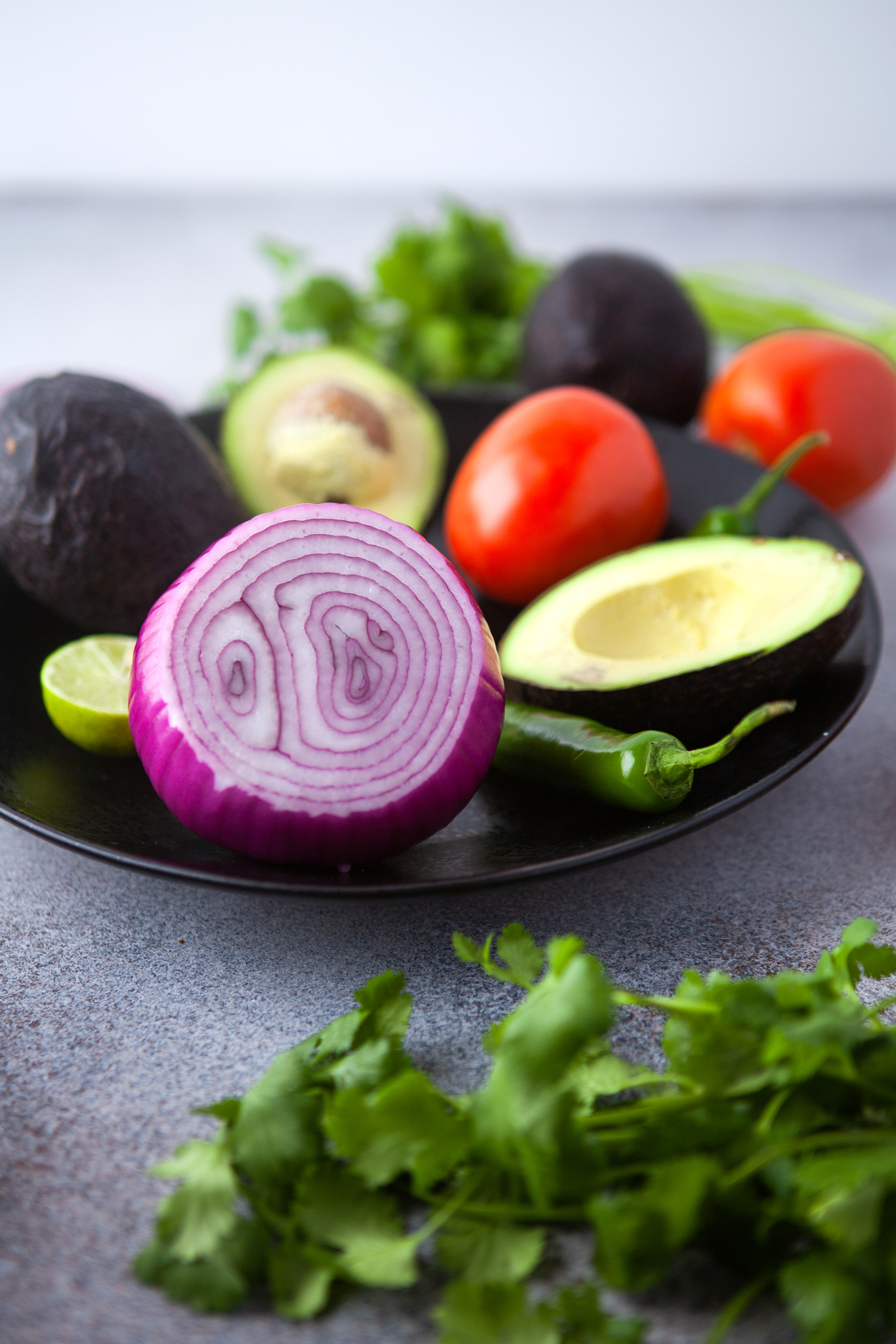 Easy Guacamole Recipe ingredients on plate.