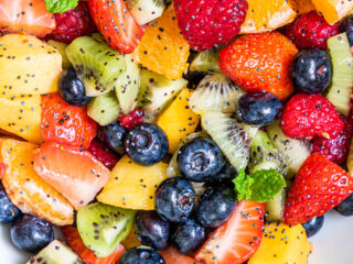 Fruit Salad with Lemon Poppy Seed Dressing on a bowl.