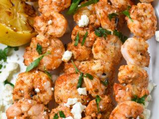 Mediterranean Grilled Shrimp Skewers on a white platter.