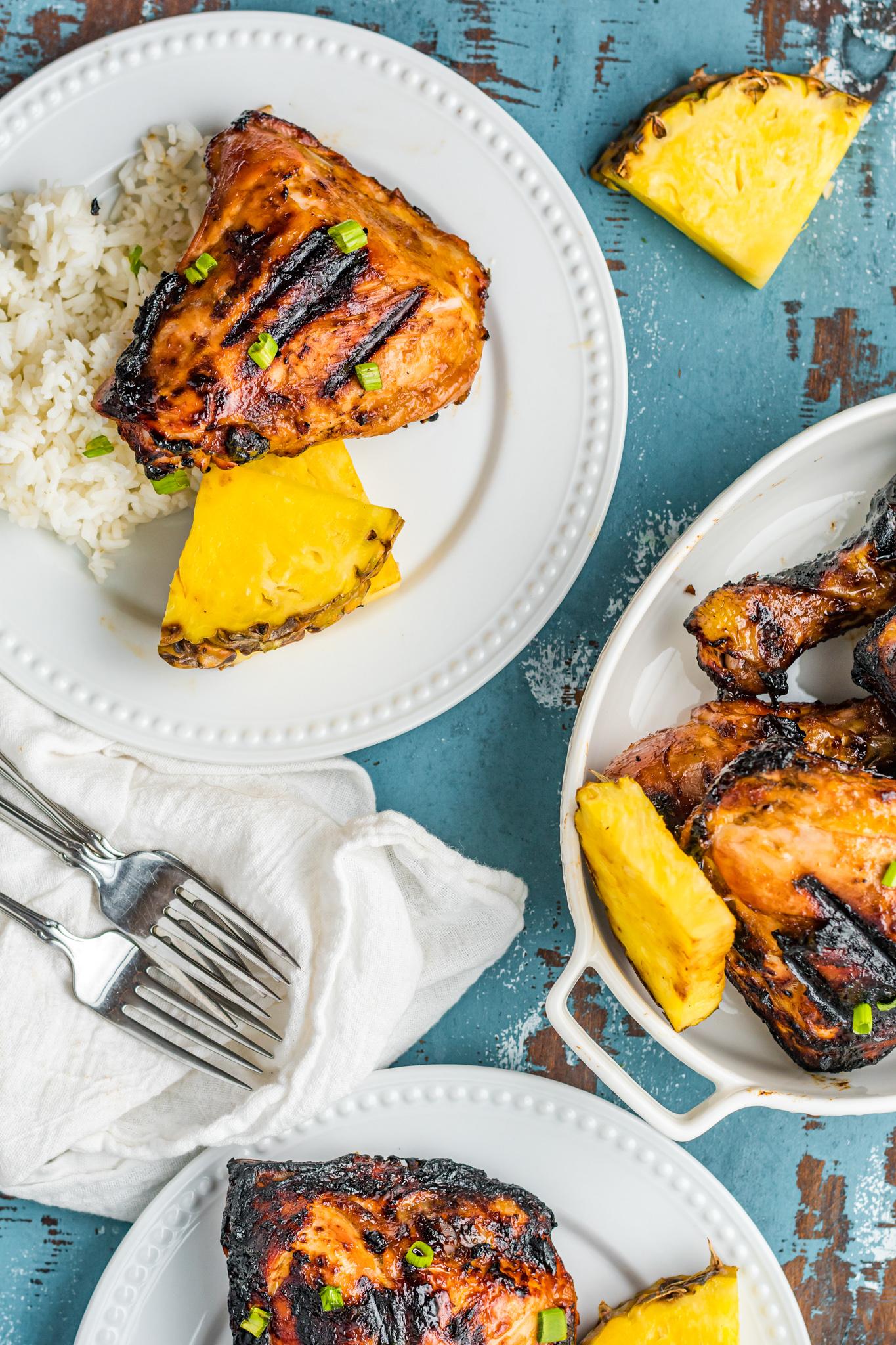 Grilled Huli Huli Chicken on white plates.