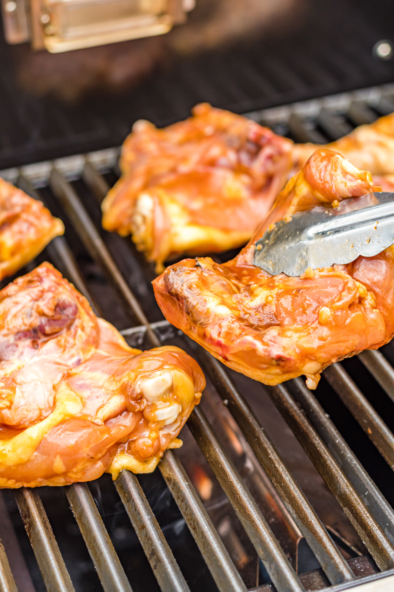 Grilled Huli Huli Chicken on the grill.