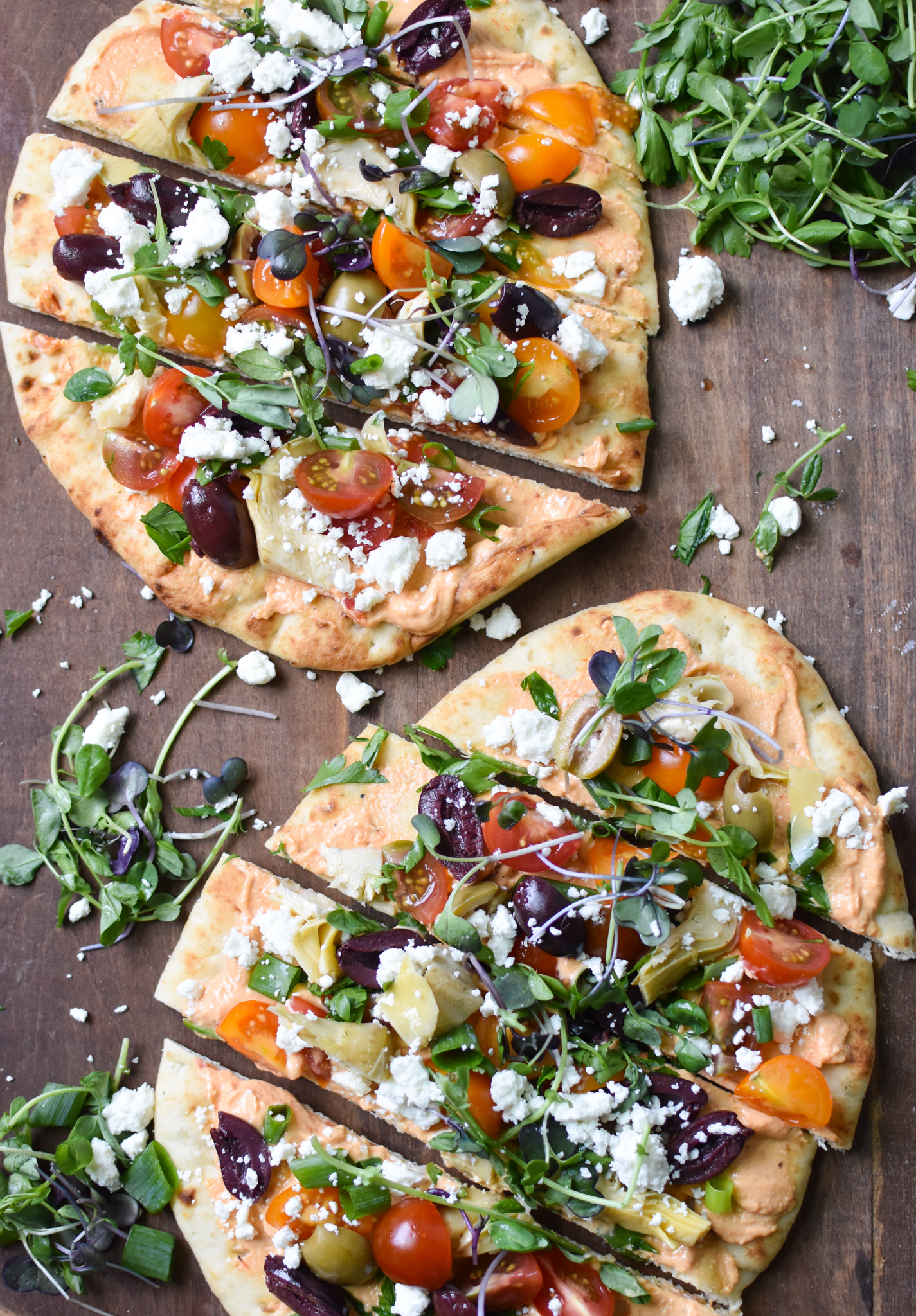 Mediterranean Naan Bread Pizza with greens.