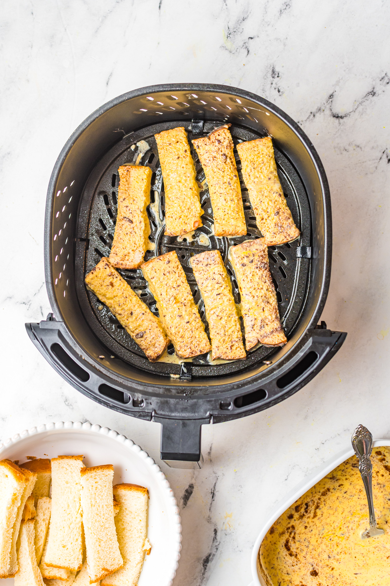 Air Fryer French Toast Sticks in air fryer.