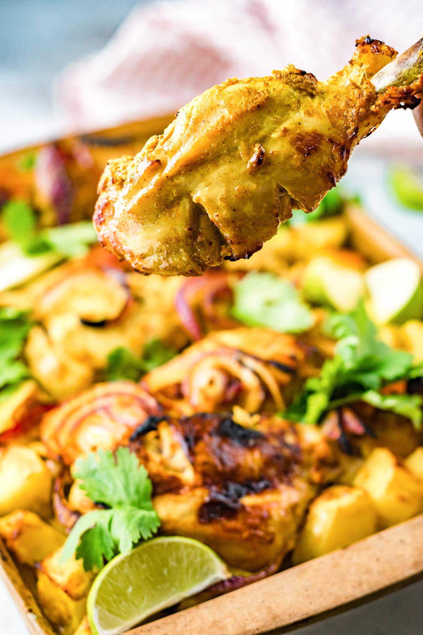 Air Fryer Tandoori Chicken Legs on a baking sheet.