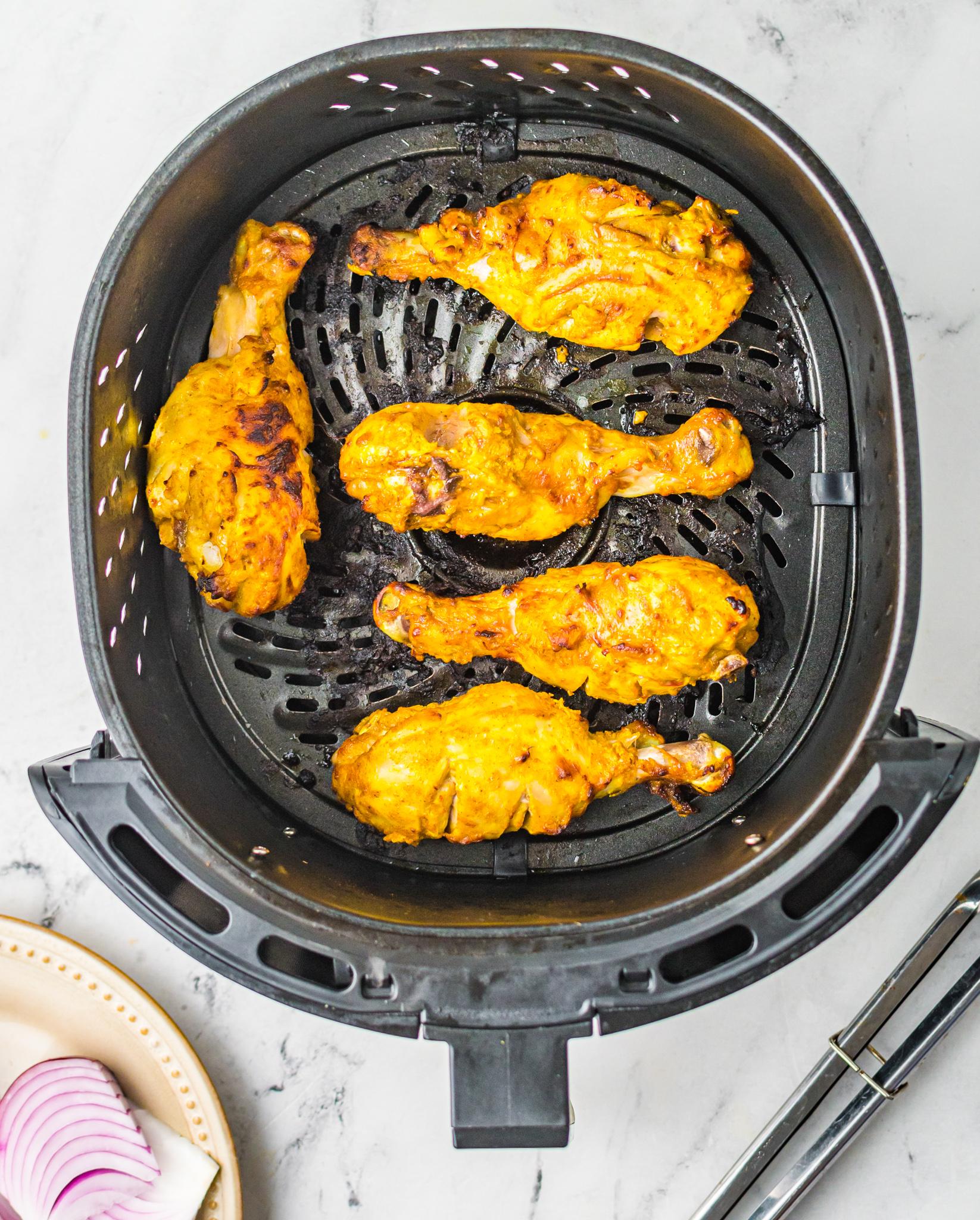 Air Fryer Tandoori Chicken Legs in air fryer.