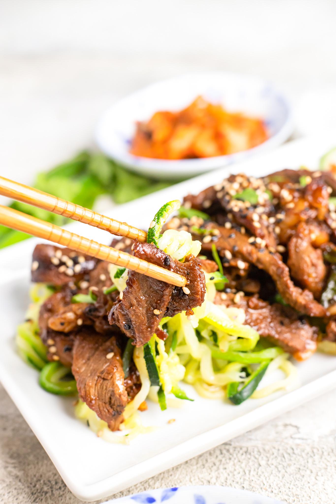 Beef Bulgogi with Zucchini Noodles with chopsticks.