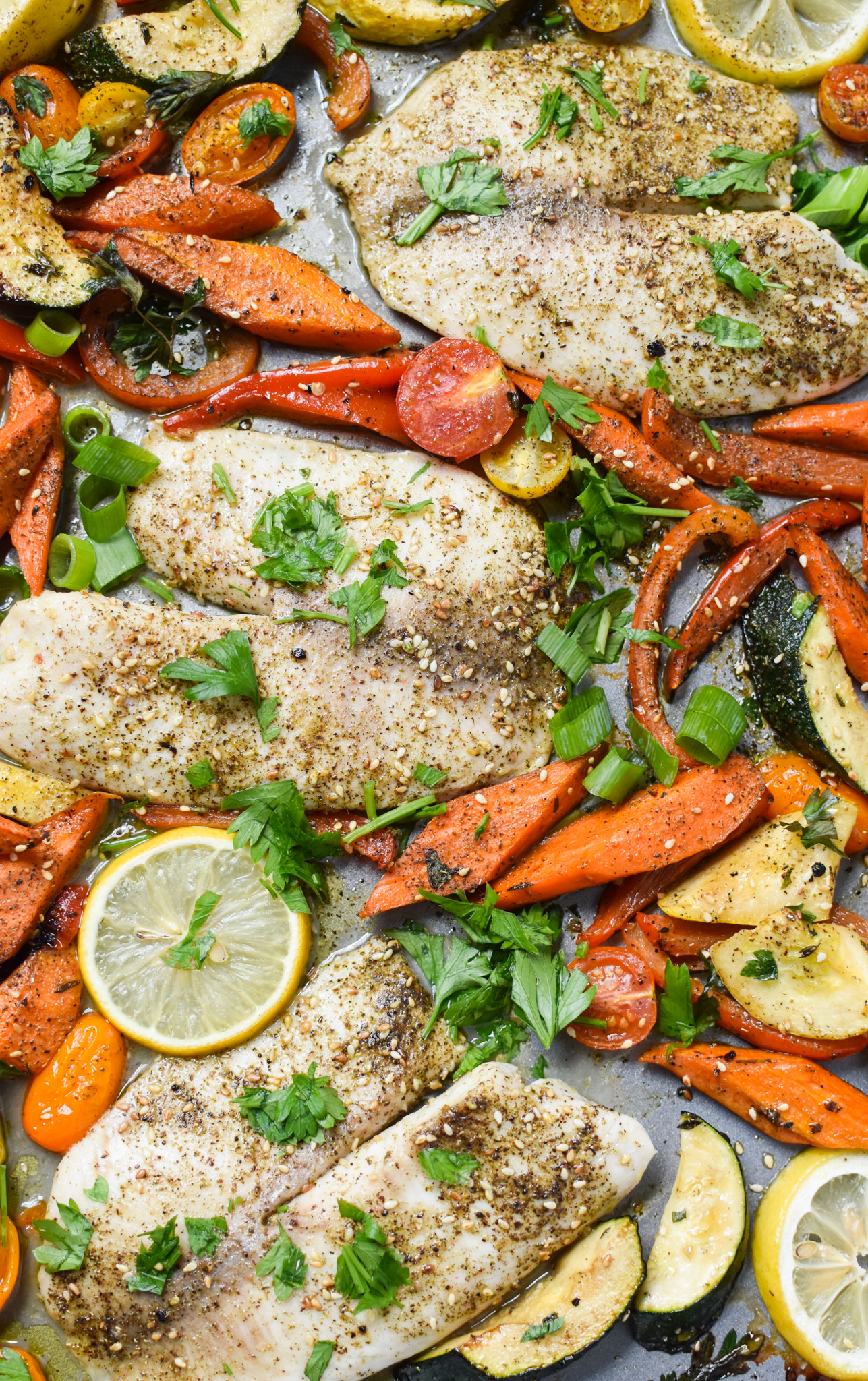 Mediterranean Baked Tilapia Recipe with lemon and vegetables.
