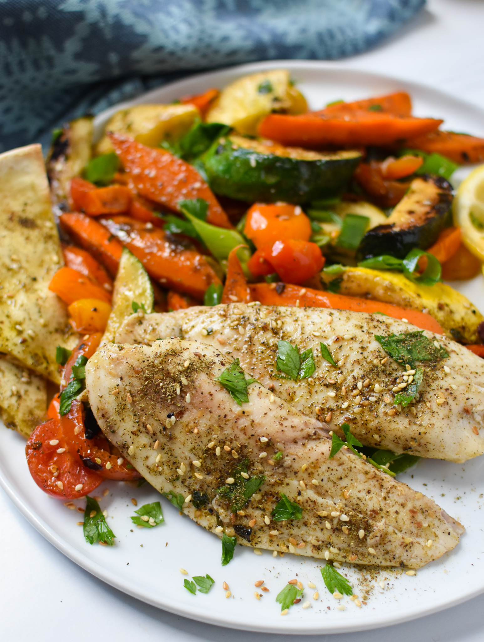 Mediterranean Baked Tilapia Recipe on a plate.