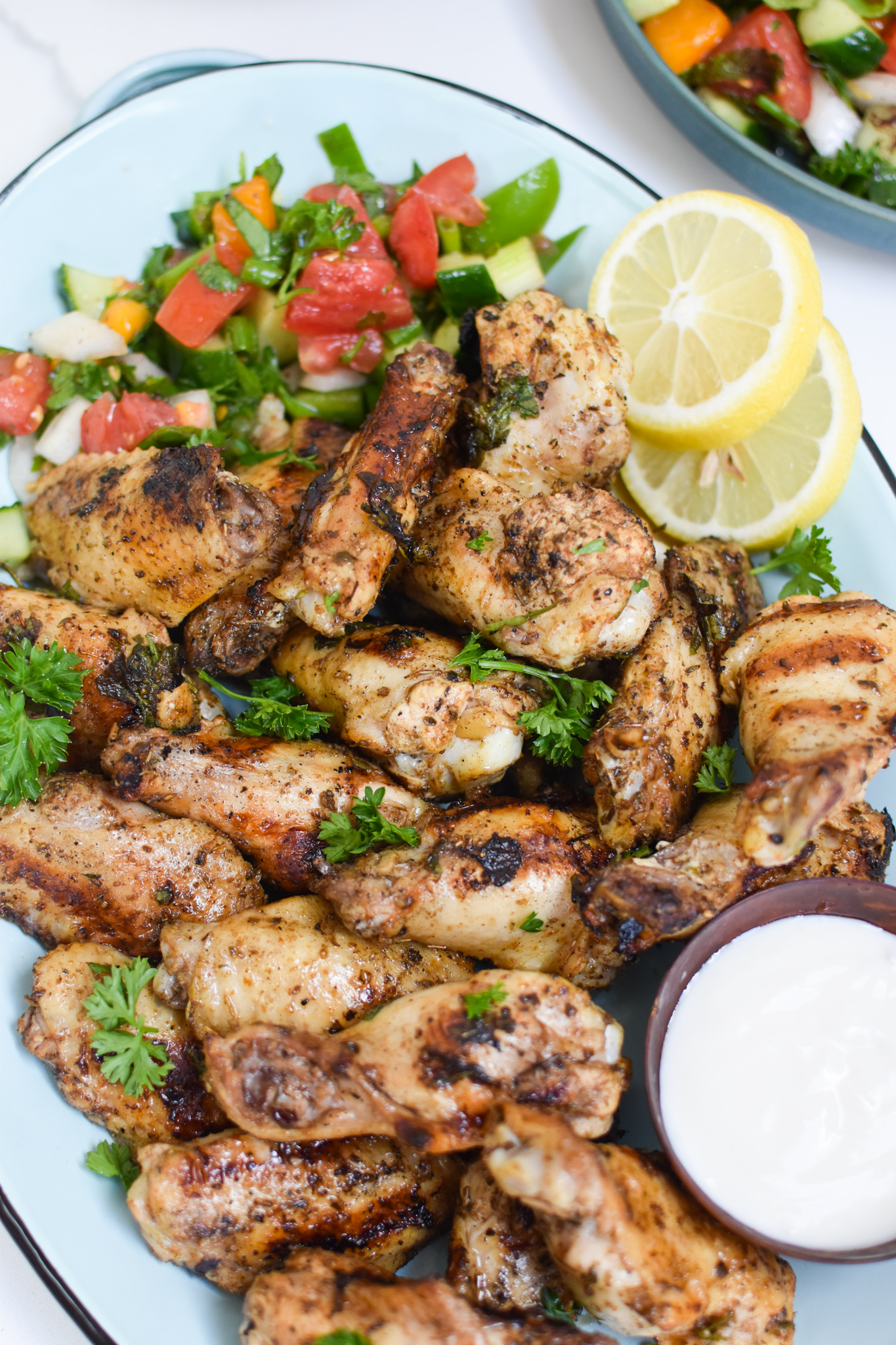 Grilled Mediterranean Chicken Wings with yogurt sauce.