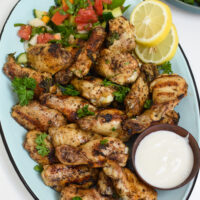 Grilled Mediterranean Chicken Wings on blue platter.