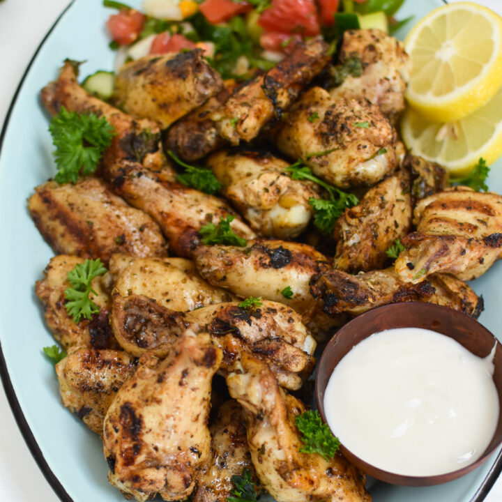 Grilled Mediterranean Chicken Wings with lemon slices.