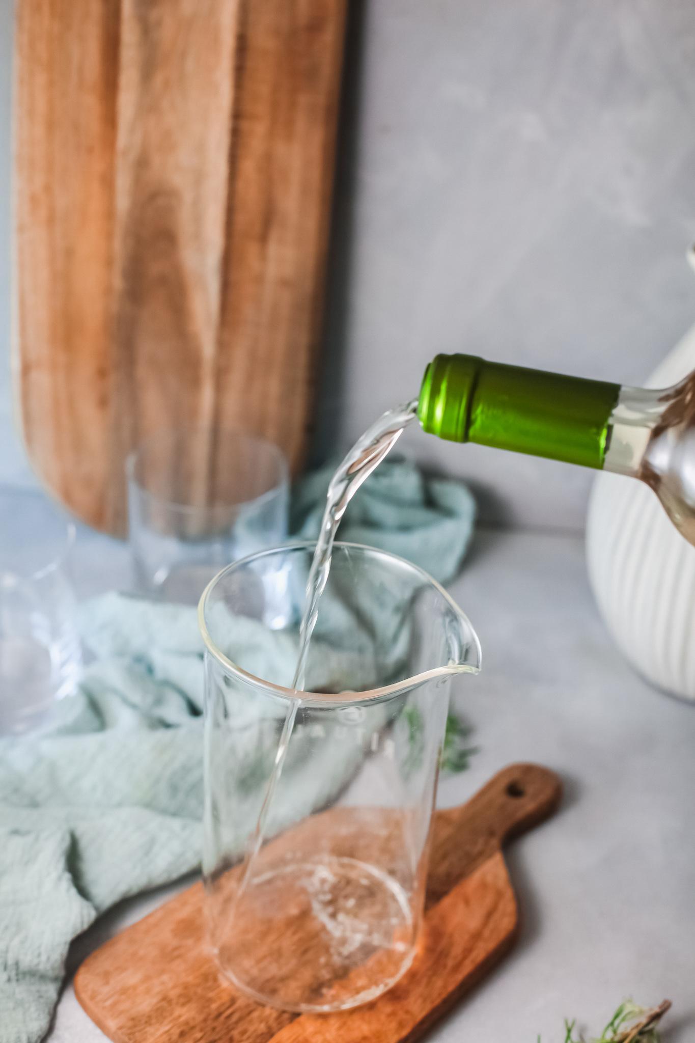 White Sangria Recipe pouring wine.