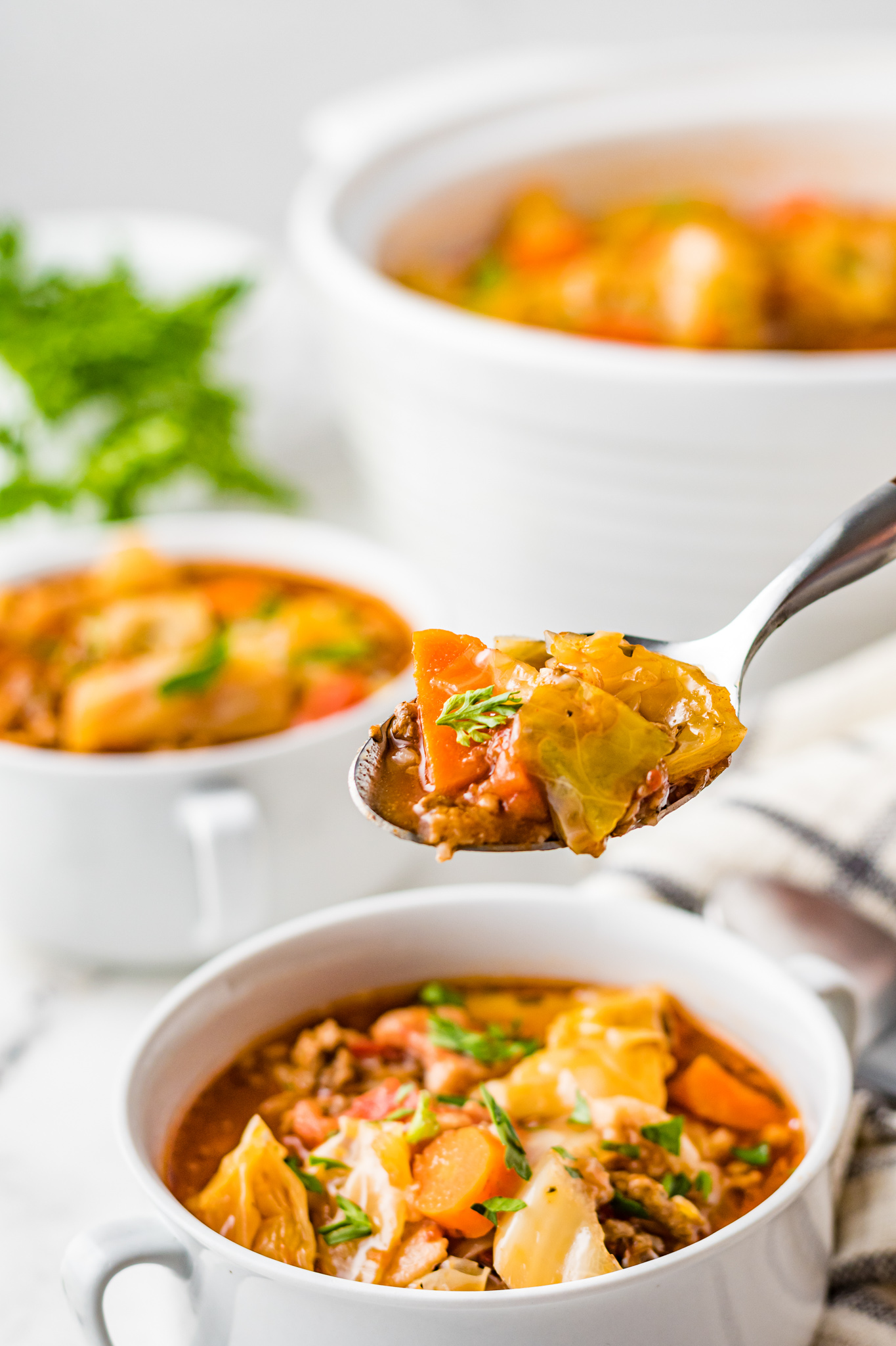 Cabbage Roll Soup with spoon.