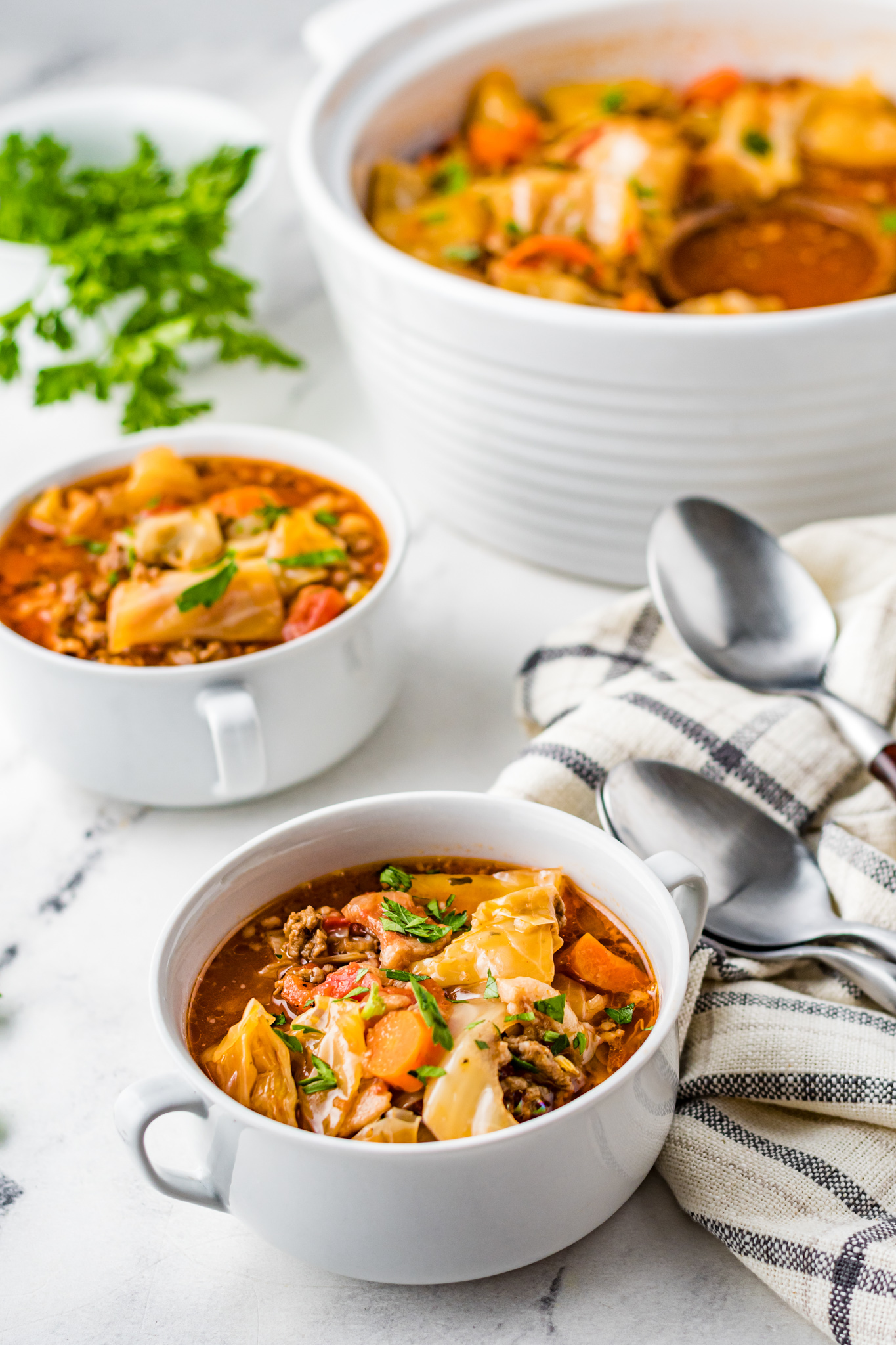 Cabbage Roll Soup in small white bowls.