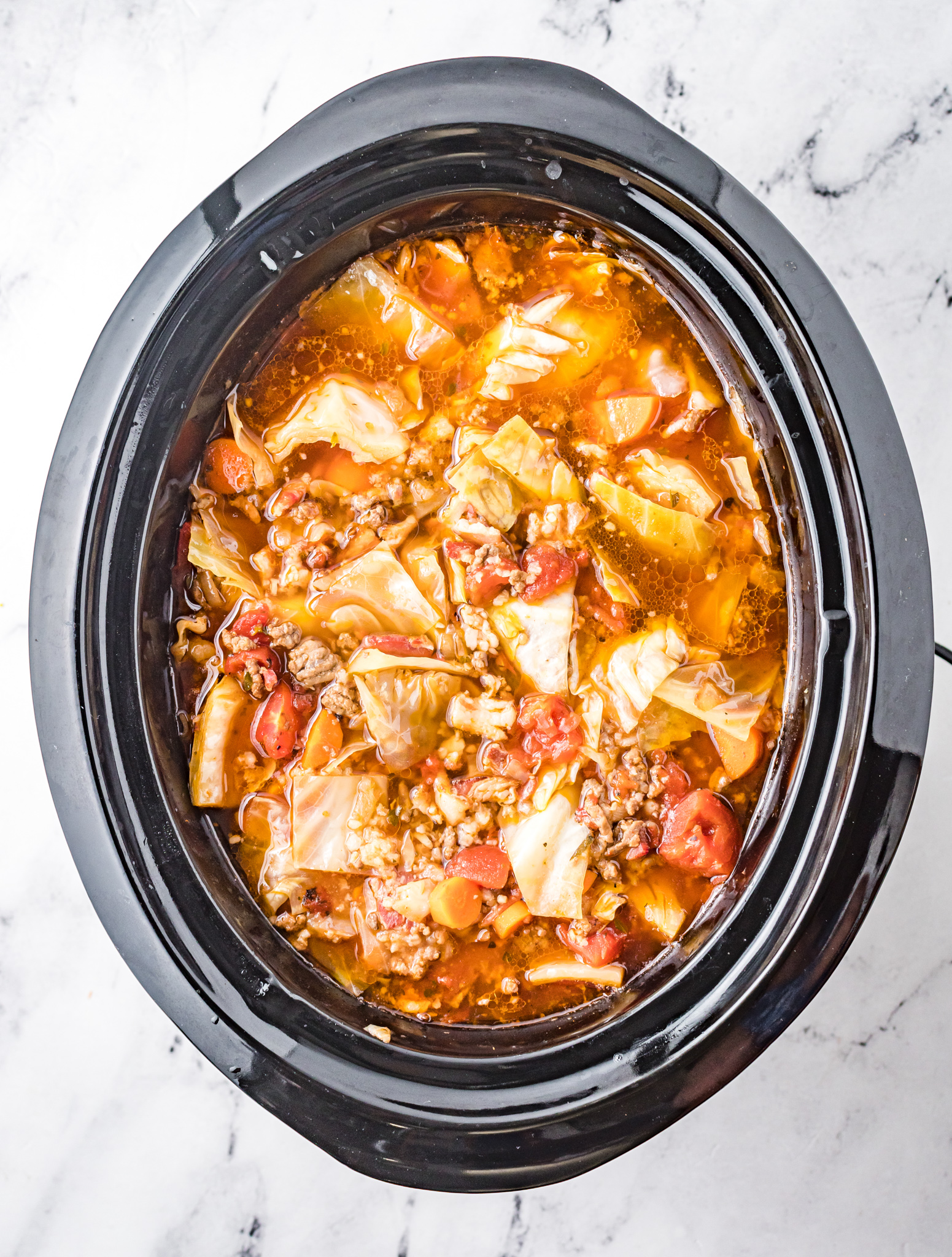 Cabbage Roll Soup cooked in a slow cooker.