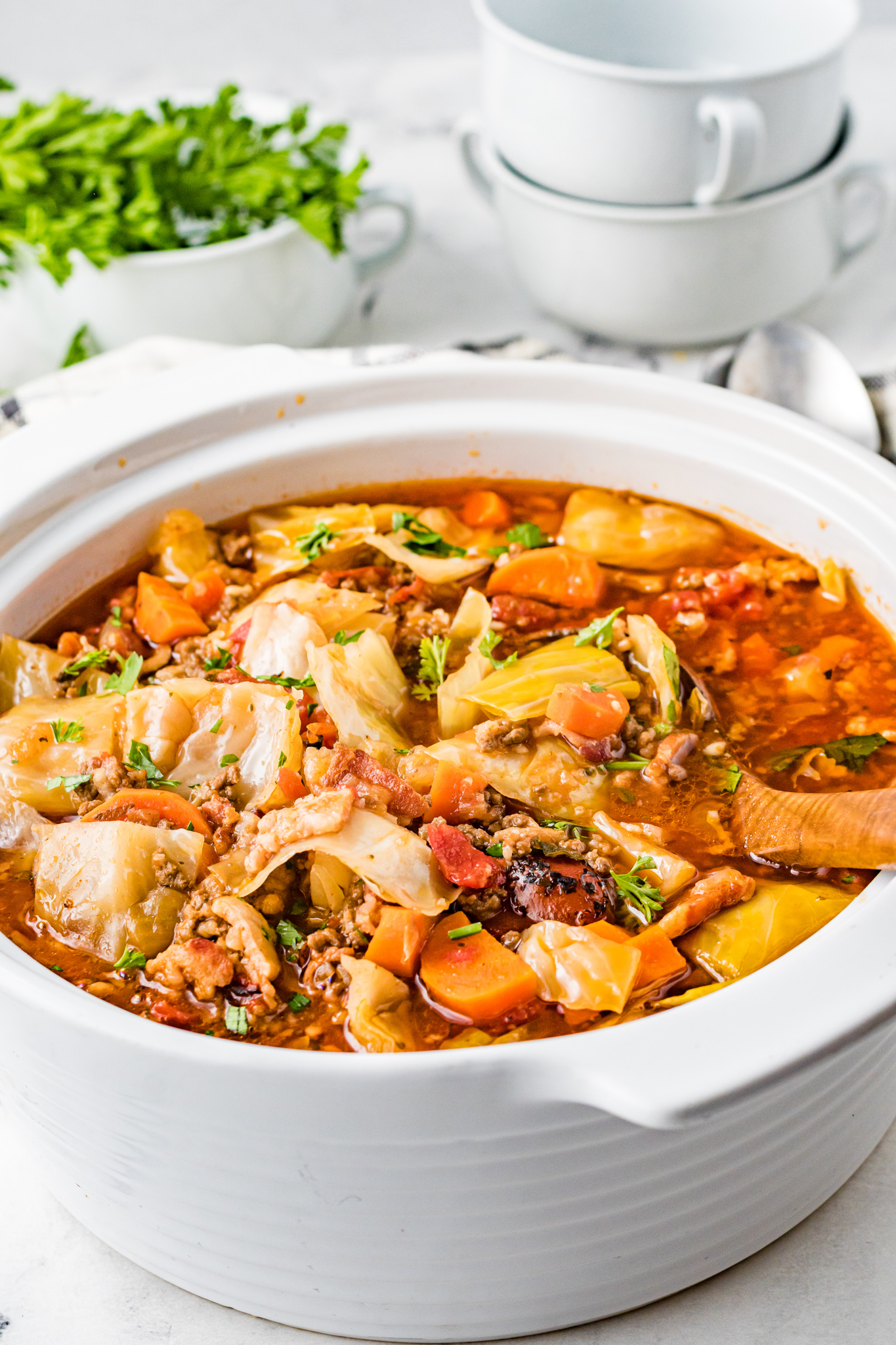 Cabbage Roll Soup with wooden spoon.