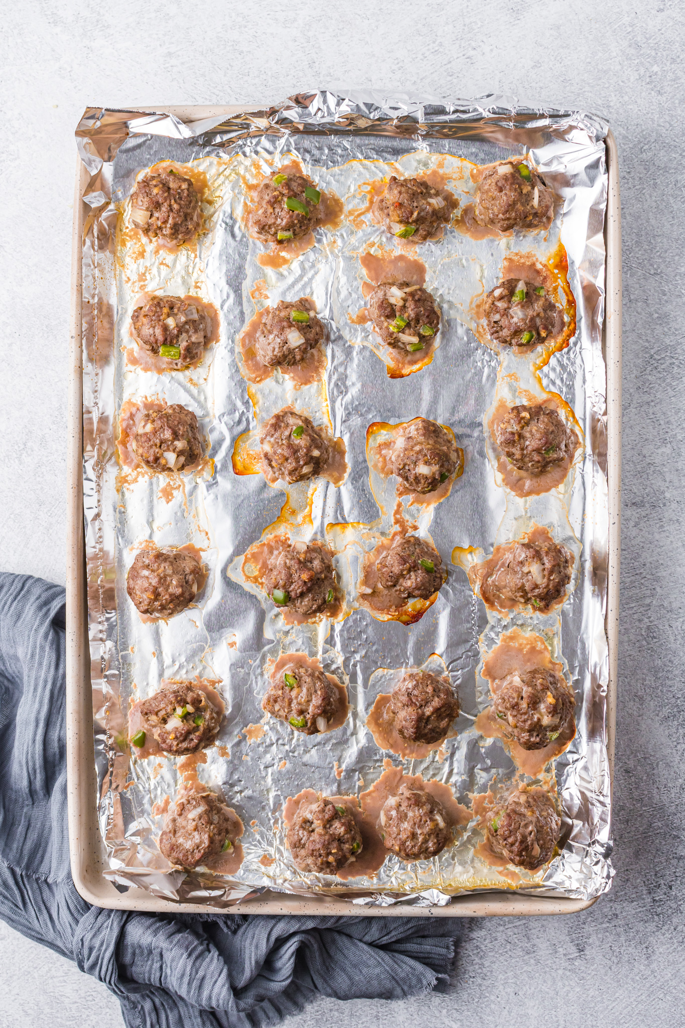 Curry Meatballs Recipe on a baking sheet.
