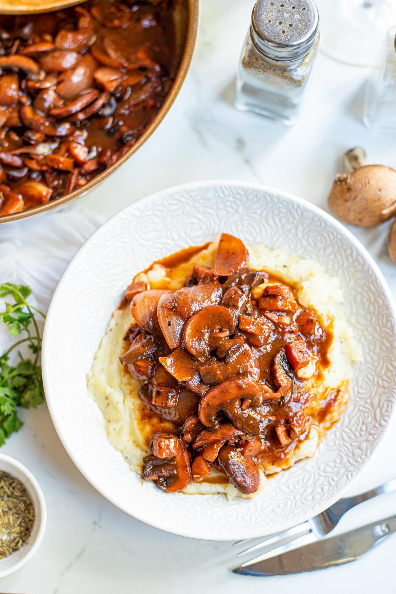 Mushroom Bourguignon in white plate.
