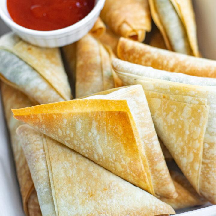 Spanakopita Triangles Recipe with sauce.