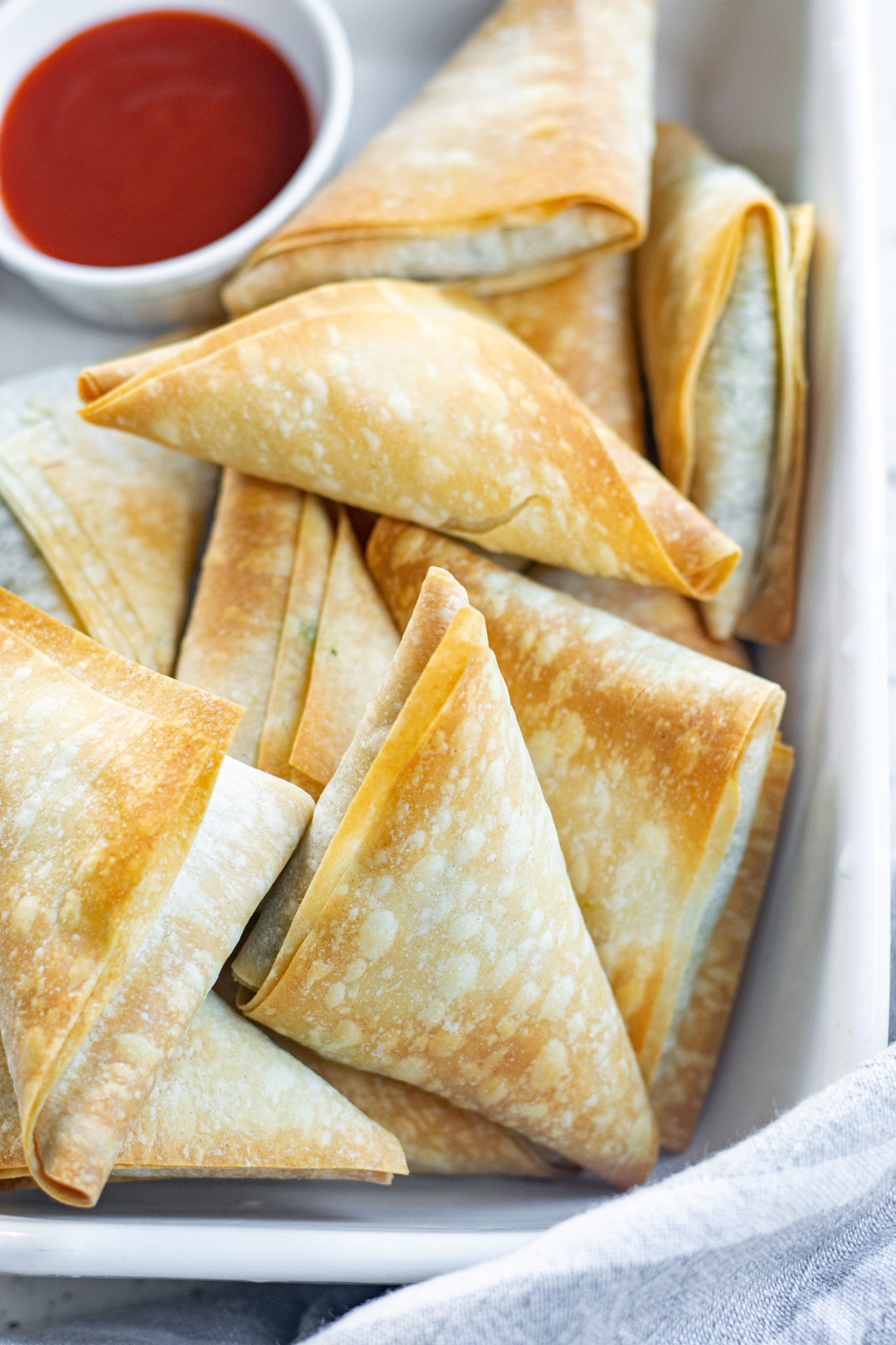 Spanakopita Triangles Recipe with red sauce.