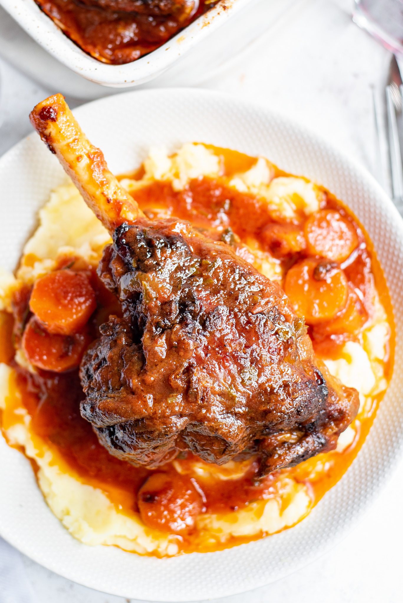 Braised Lamb Shanks Recipe with carrots.
