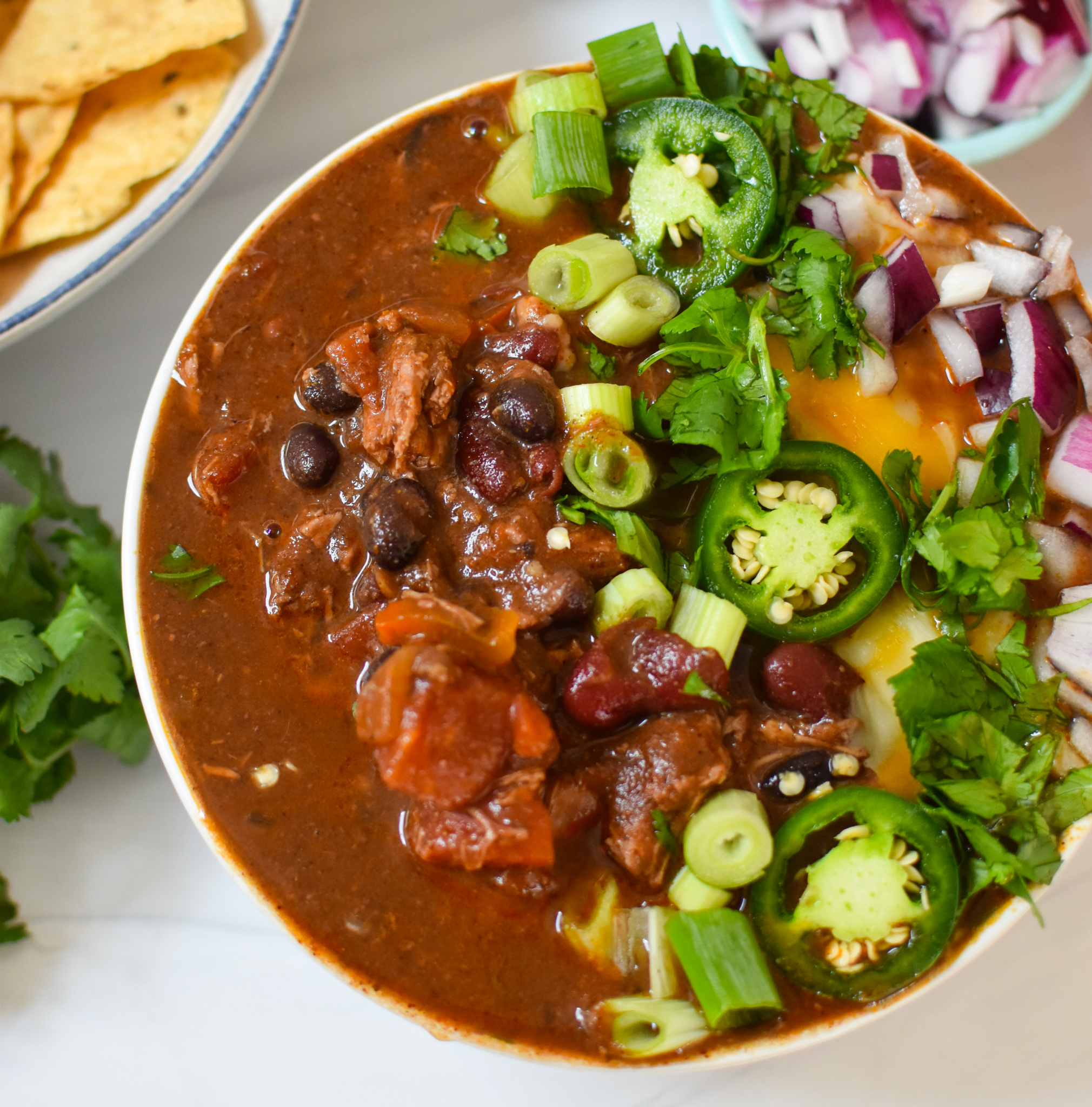 Chili Con Carne with red onion.