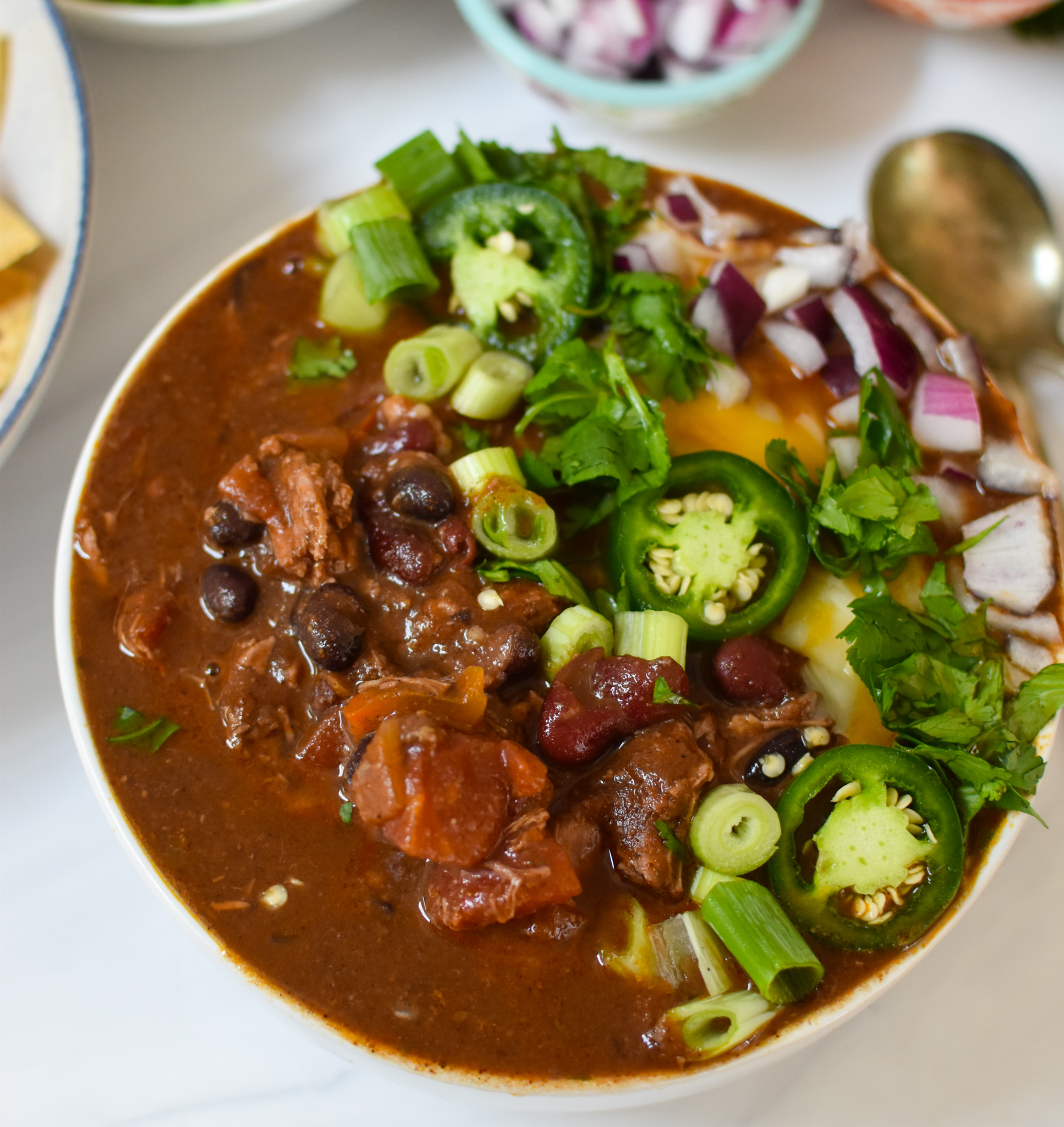 Chili Con Carne with garnishes.