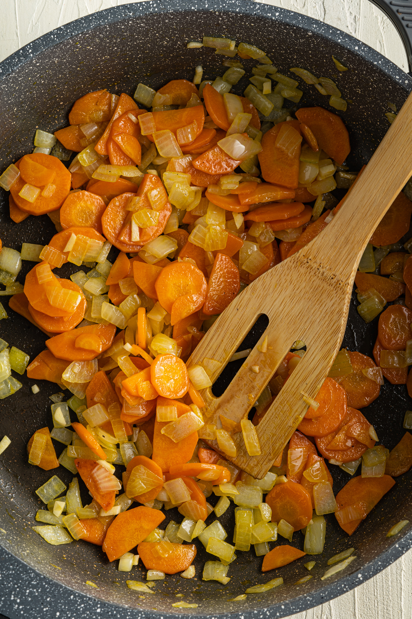 Lentil Sweet Potato Stew Recipe with a spatula.