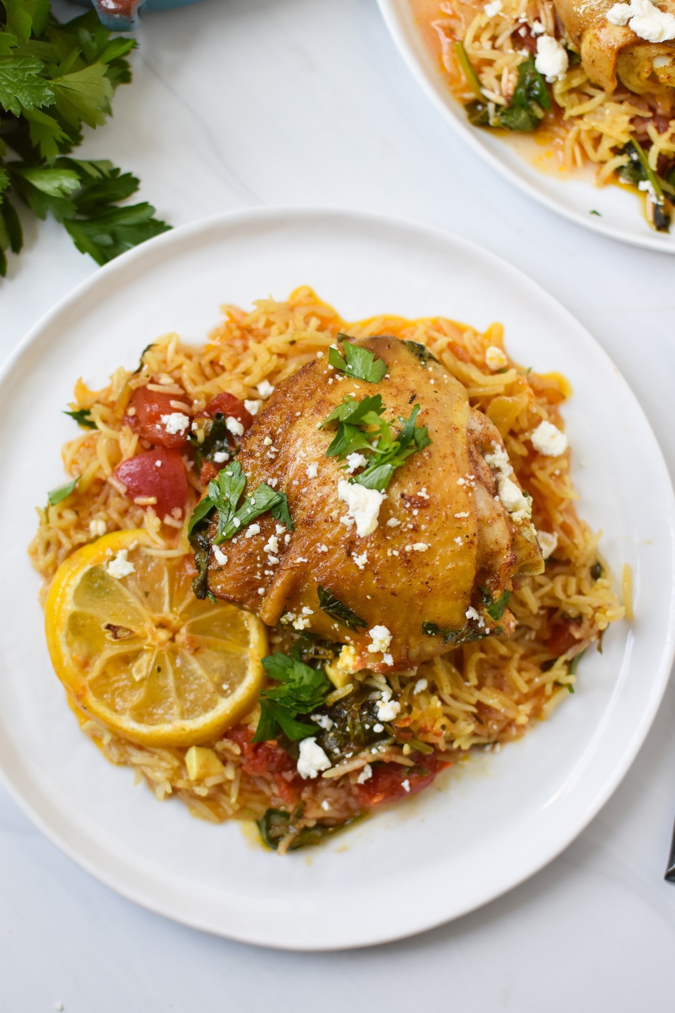 One Pot Mediterranean Chicken and Rice on white plate.