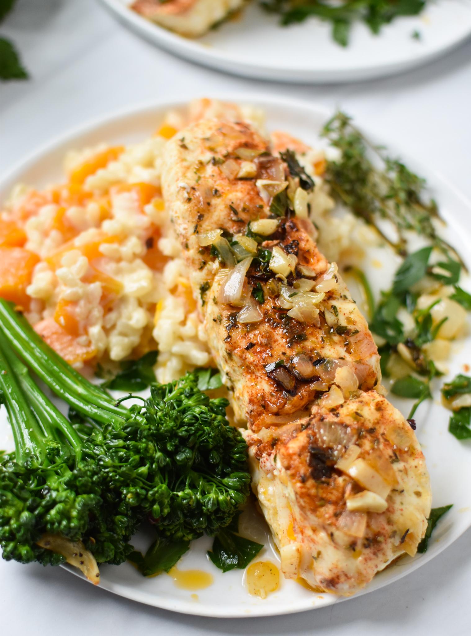 Lemon Garlic Halibut Recipe with broccoli on plate.