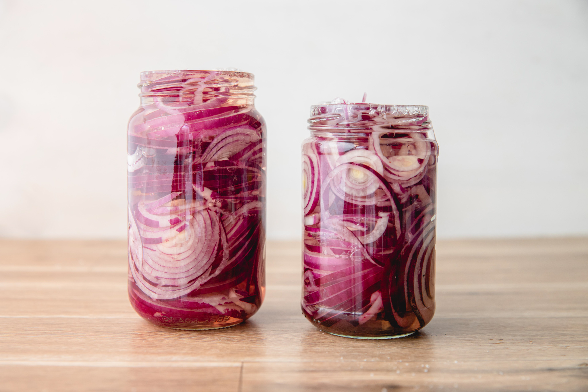 Quick Pickled Red Onions in mason jars.