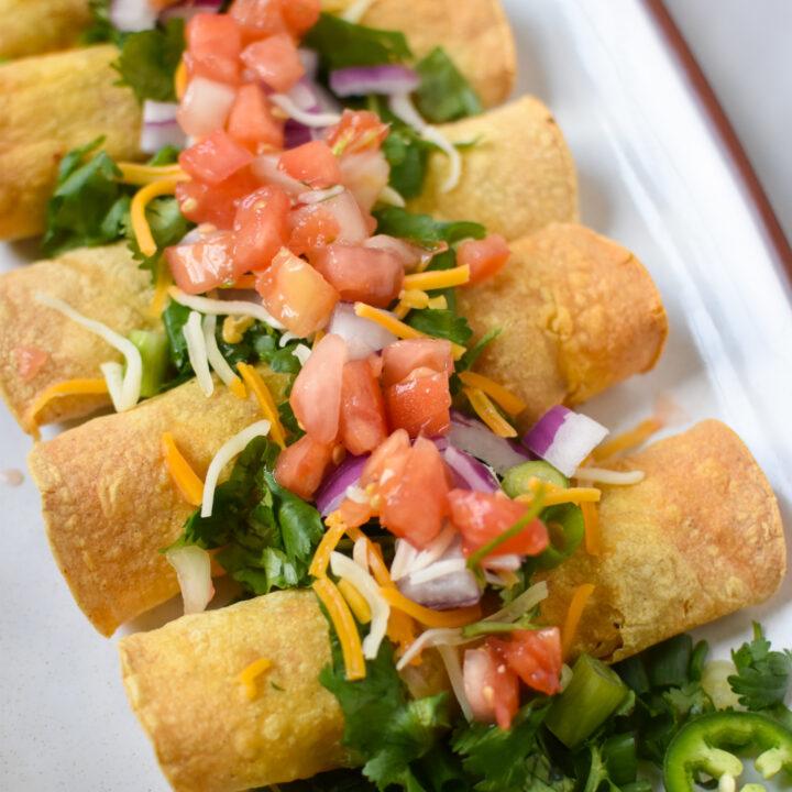 Air Fryer Pork Taquitos with pico de gallo.