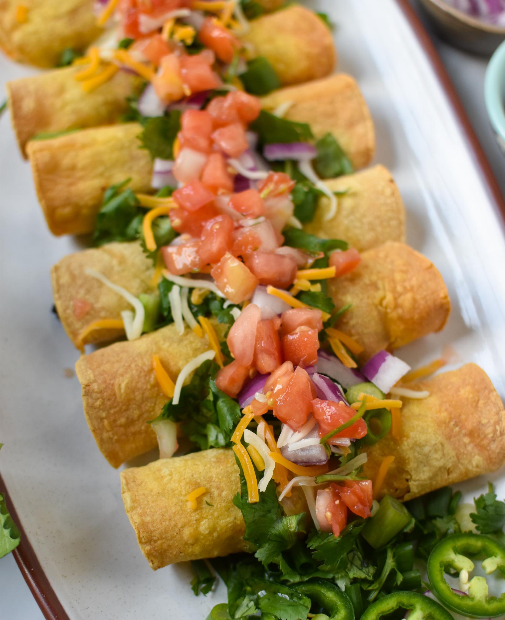 Air Fryer Pork Taquitos with cilantro.